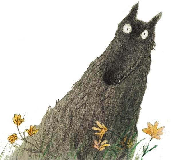 Der Wolf sitzt in Blumenwiese und schaut mit großen Augen